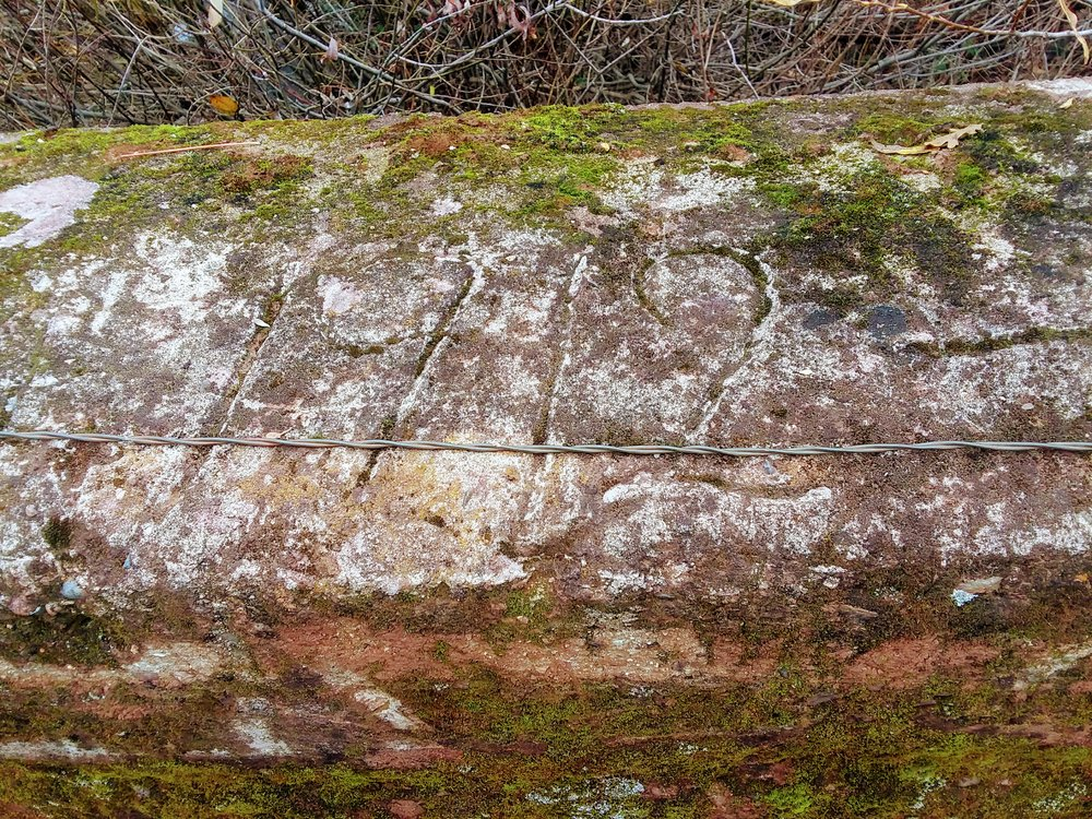 The date 1912 etched into the copper hued concrete of one of the bridges.