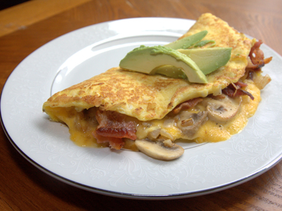 OMELETTE WITH CHEESE, BACON, MUSH & AVO
