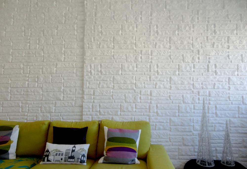 esta parede, feita pelo seu avô, é o pormenor que mais gosta da casa.