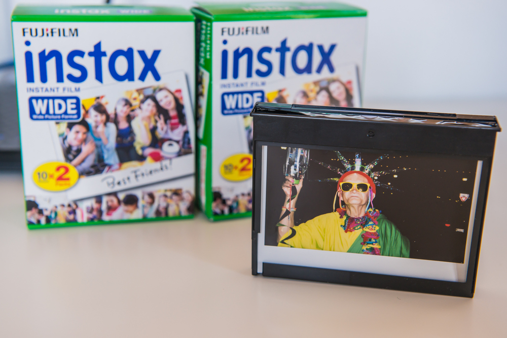 Instead of throwing the plastic cases away, I like to use them as frames for my photos.