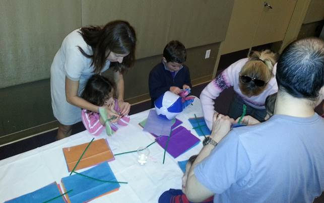 Families working together on arts & crafts projects