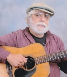 Gerry Tenny with guitar.jpg