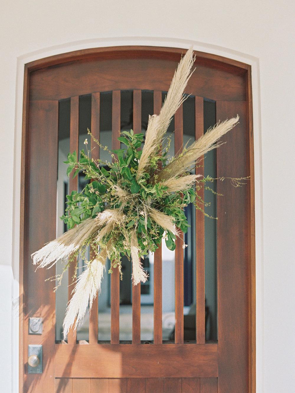 jessica-zimmerman-lauren-kinsey-wedding-door-wreath-greenery.jpg