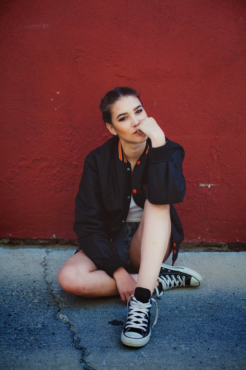 Brandy Melville top / H&M shorts / Vintage varsity jacket Photos by: James Stewart