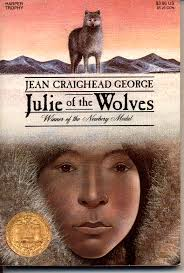"JULIE OF THE WOLVES by Jean Craighead George    ""Miyax pushed back the hood of her sealskin parka and looked at the Arctic sun. It was a yellow disc in a lime-green sky, the colors of six o'clock in the evening and the time when the wolves awoke.""    read 7/28/14"