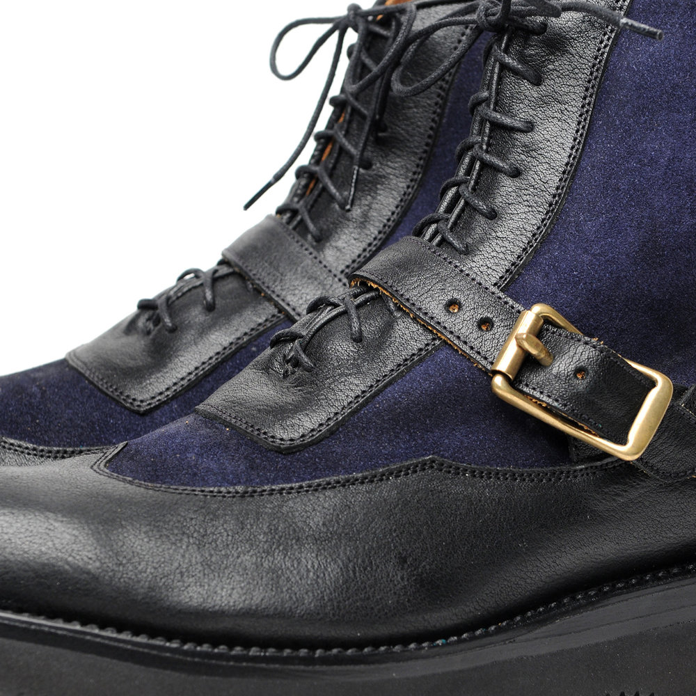 42-1668-SP-SIERRA-WINGTIP-BOOTS-W-STRAP-BLACK-NAVY-CLOSE-UP.jpg
