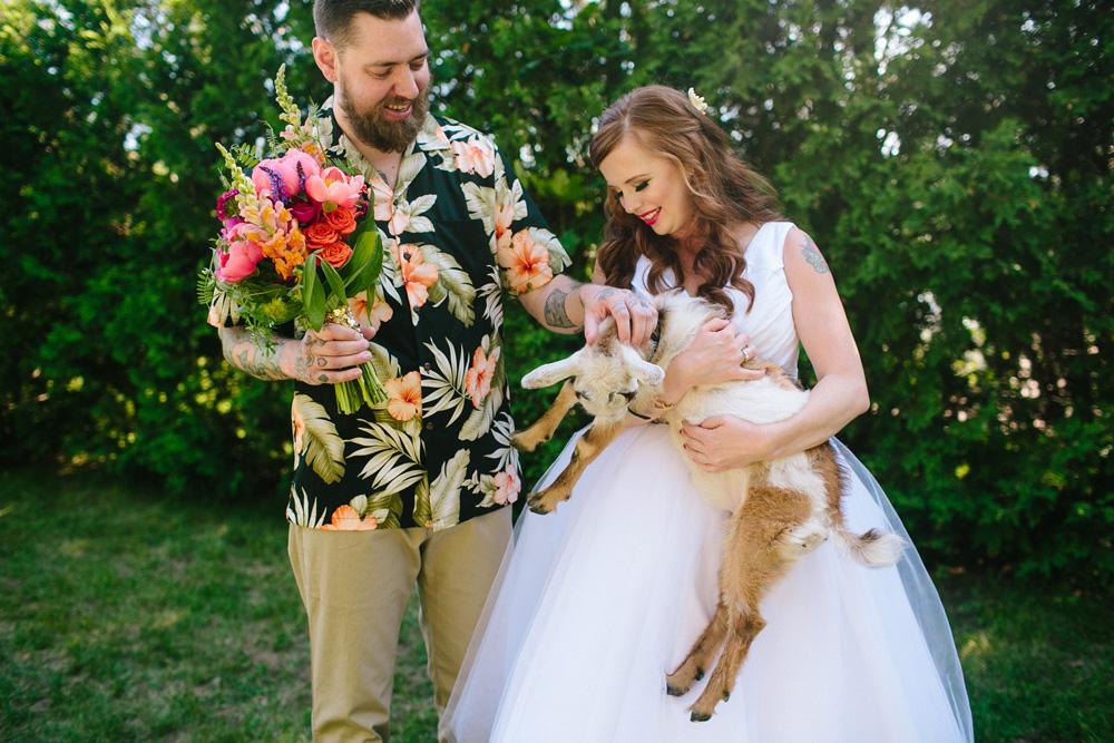 025-bride-holding-goat.jpg