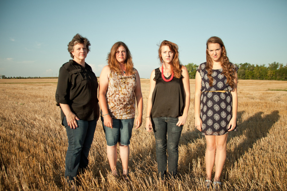 Self-portrait with my mom and two sisters I come from a strong family of Midwestern women.  My mom raised three different, but smart and beautiful women.  And my mom herself is stronger and more beautiful than anyone I know. [September, 2013; Brookings, SD]
