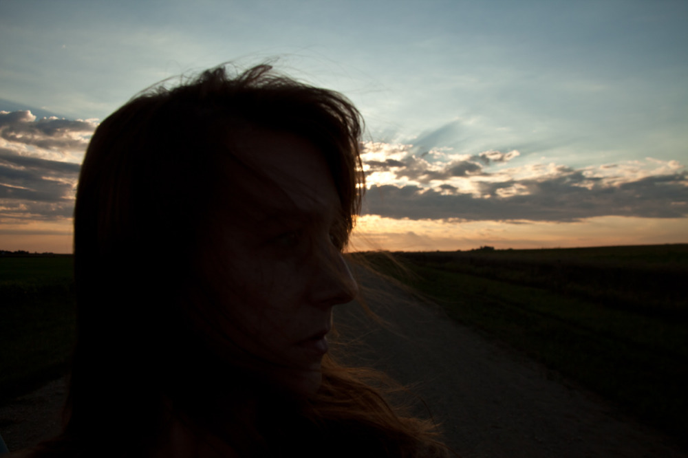 Self-portrait, at sunrise in the fields. My favorite time and place. [September, 2013; Brookings, SD]