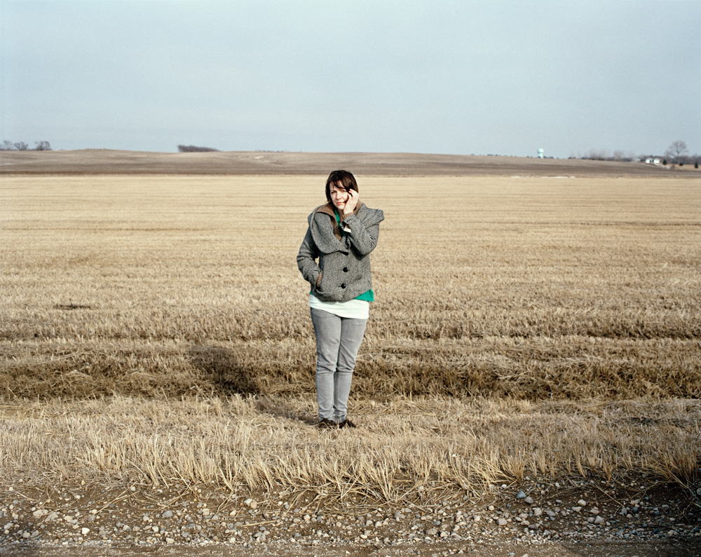 Spring    This was one of the first self-portraits I ever made in South Dakota.  It might have been the very first one actually.  At that point, I wasn't sure why I needed to make a self portrait.  I think I just really wanted to put a person in that landscape, but I was the only person around.  I still love this photograph.  It kind of perfectly portrays myself, the landscape, and my relationship to South Dakota.  It's a simple photo, but still pretty powerful for me.   [from   Expanse  ; April, 2008; Brookings, SD]