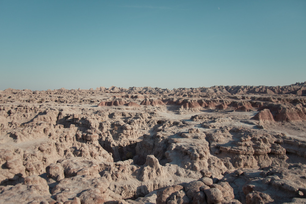 The moon in the sky proves this isn't the moon itself. [from Scape; October, 2011; Badlands National Park, SD]
