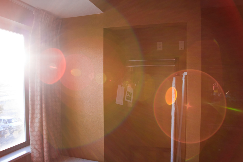 Self portrait (look for it) at sunrise in a quality hotel in New Mexico   [from   Scape  ; September, 2011; Farmington, NM]