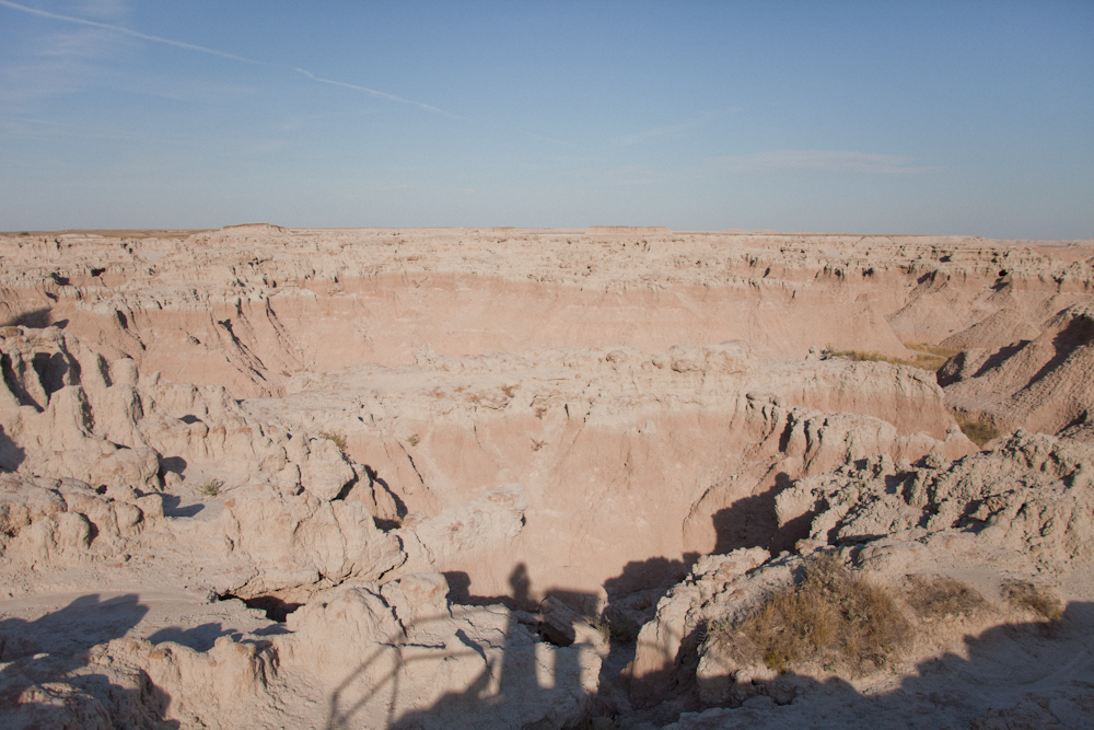 Self portrait with a railing, informational plaque, and the landscape   [October, 2011;  Badlands National Park, SD]