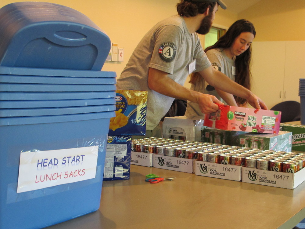 Spencer and Paige help sort food at an MLK Day event