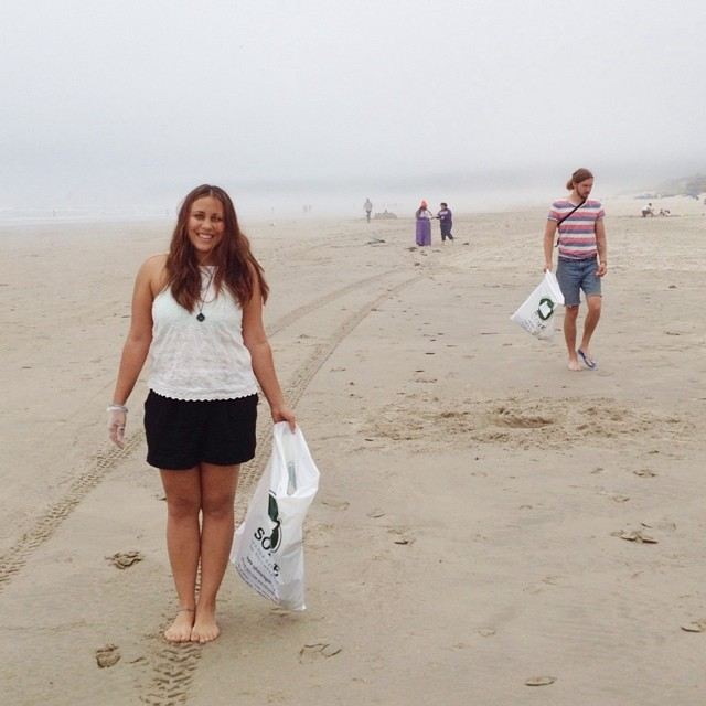 Danielle and Michael help clean up the beach during at team meeting