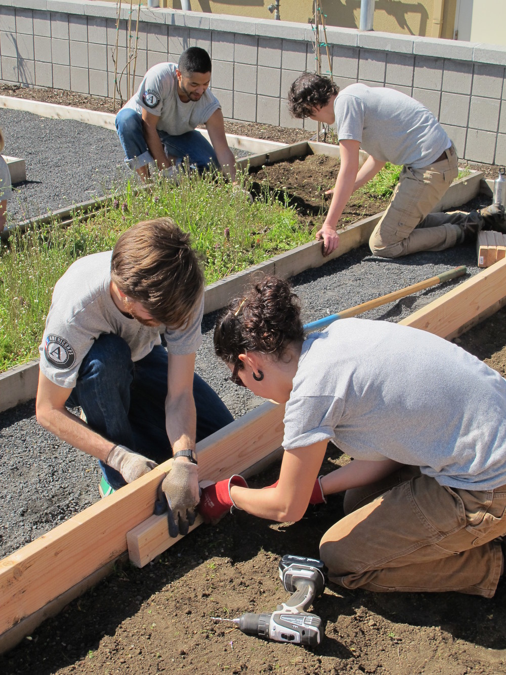 Building and weeding garden bedsat Virginia Garcia Memorial Health Center