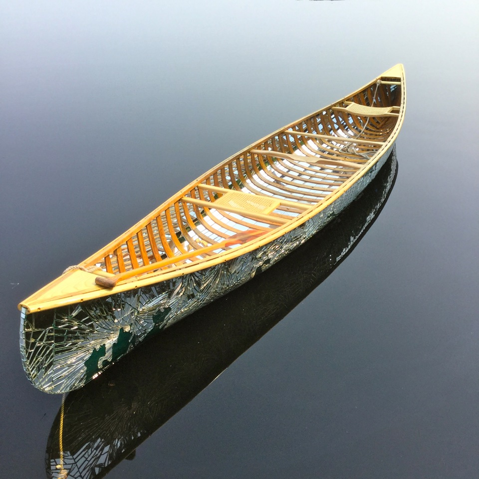 Reflections – the mirrored canoe.
