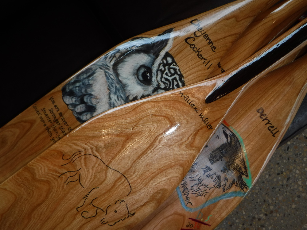 A close-up shot of some of the student's completed paddles.