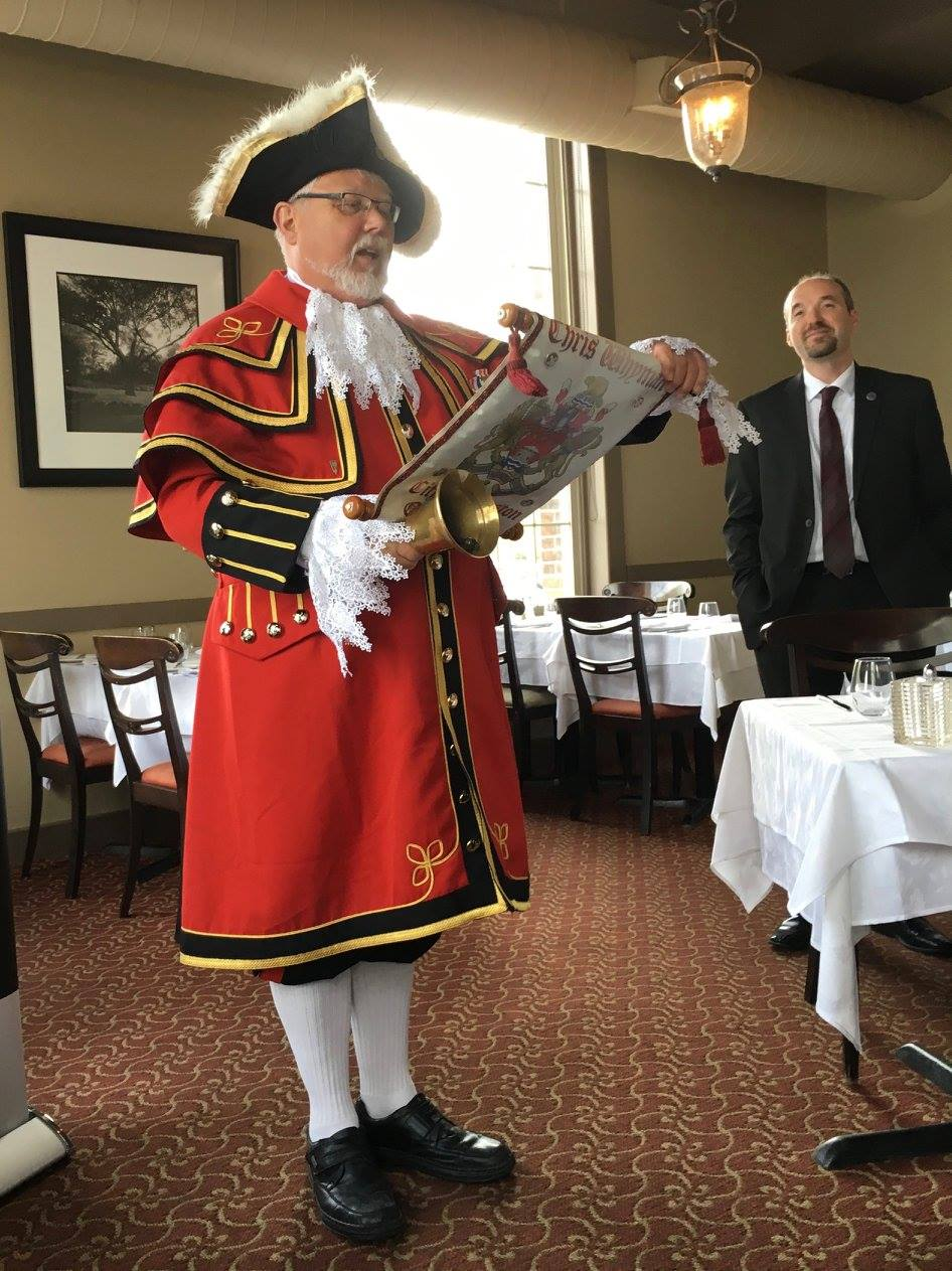 City of Kingston Town Crier, Chris Whyman, with Kingston Mayor, Brian Patterson, welcomes the crew to Kingston at an event in the River Mill Restaurant organized by Tina Bailey, Executive Director of the Kingston and District Community Foundation.