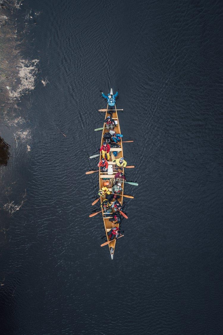 overhead photo of the canoe with participants paddling