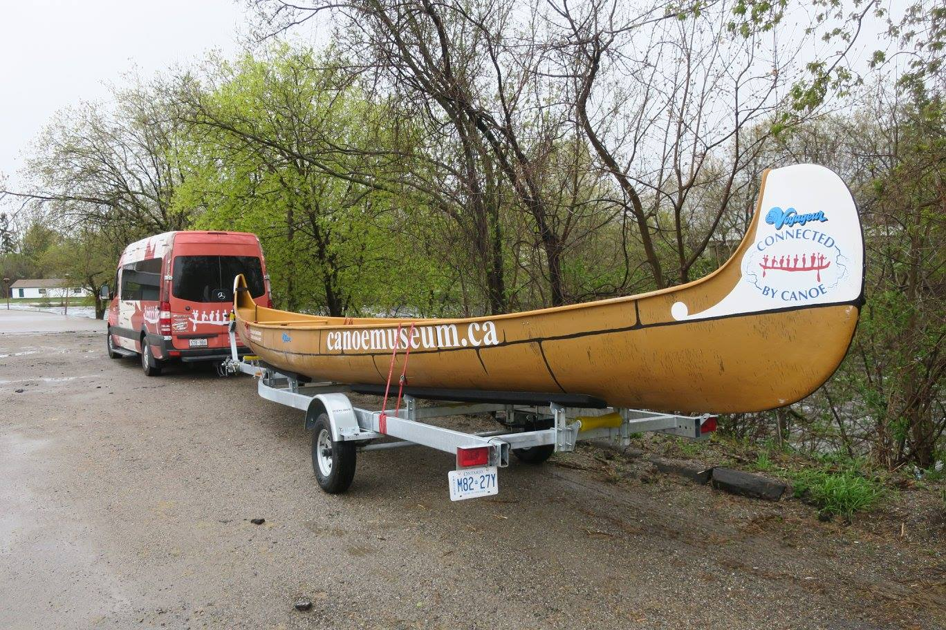 the canoe for the journey on it's trailers being pulled behind the museum van
