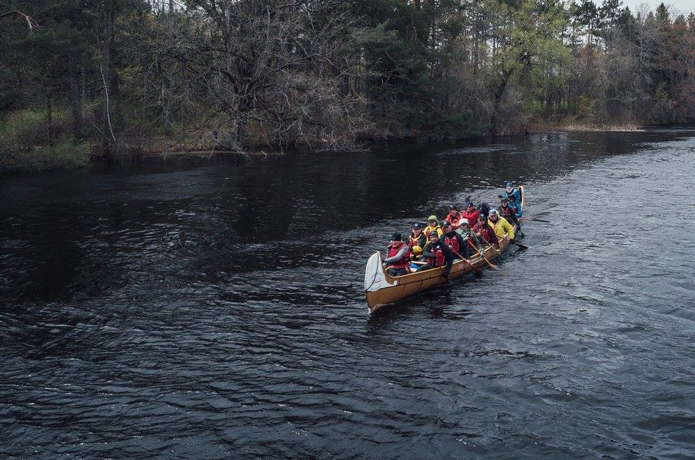 participants paddling the canoe down the waterway