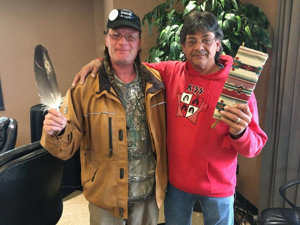 Chuck Commanda and Stephen holding eagle feather