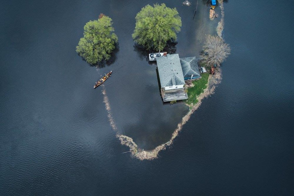 overhead shot of a property fully flooded by the river