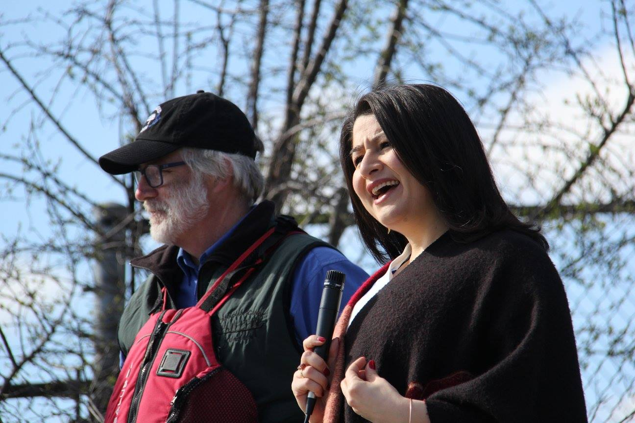 Maryam Monsef speaking with microphone