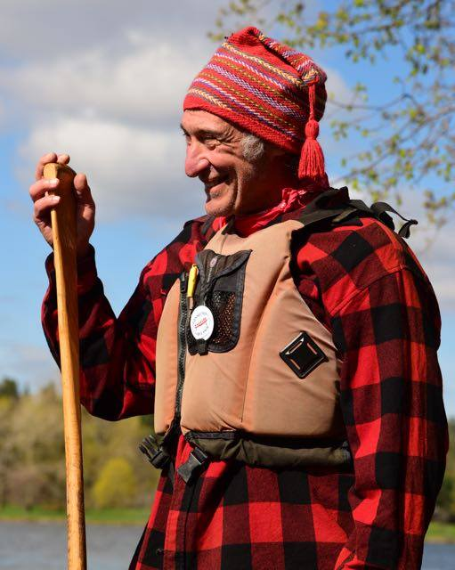 a man holding a paddle smiling