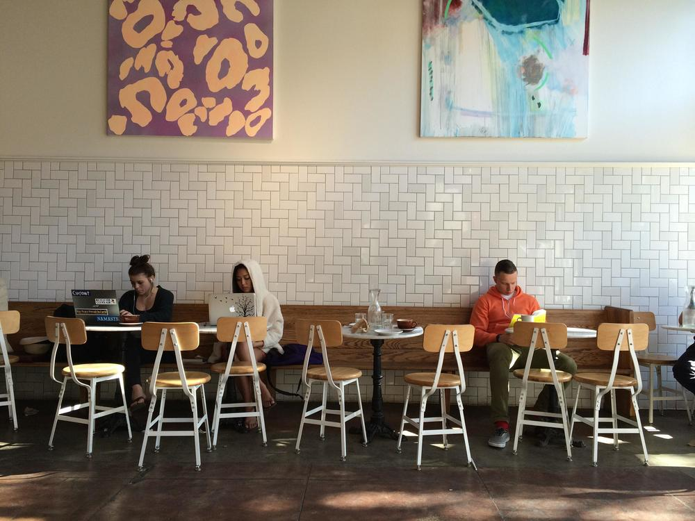 Emphasizing natural lighting, attractive wall art, and seating options can make a difference in customer retention.