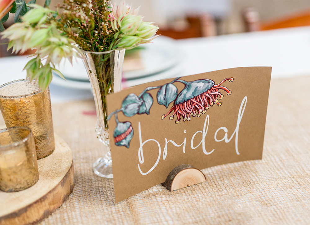 Hand painted bridal table sign featuring Eucalypt Rhodantha