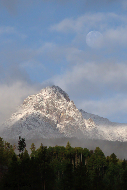 Late-September snows blanket Silverthorne Mountain under the harvest moon.