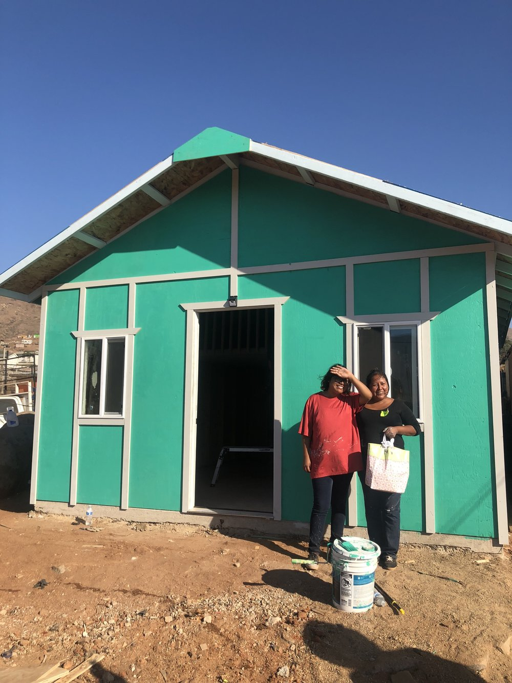 This is Marleni and Jacqueline in front of their new soon to be home. Marleni is a single mom working in factory making about 1050 pesos ($55.20 USD) a week. Jacqueline is 15 and hopes to be a neurosurgeon someday. Not pictured is Marleni's son, Angel, who is 8 years old. He was there and very excited for his new house. Marleni works at night and is not able to be home most of the time to make sure her children were safe. Their original house did not have a secure lock and Marleni worried about her kids constantly. The most important thing to her was improved security. Best believe we provided that for her and seeing her cry tears of joy and appreciation towards us made me happy to put my name on that day.