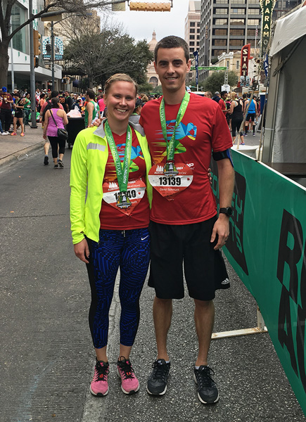 Kristina and her husband showing off their Finisher's medals at the 2016 Austin Marathon.