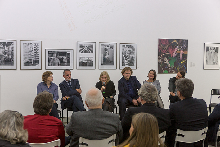 Discussion at the opening ceremony, with my painting in the background