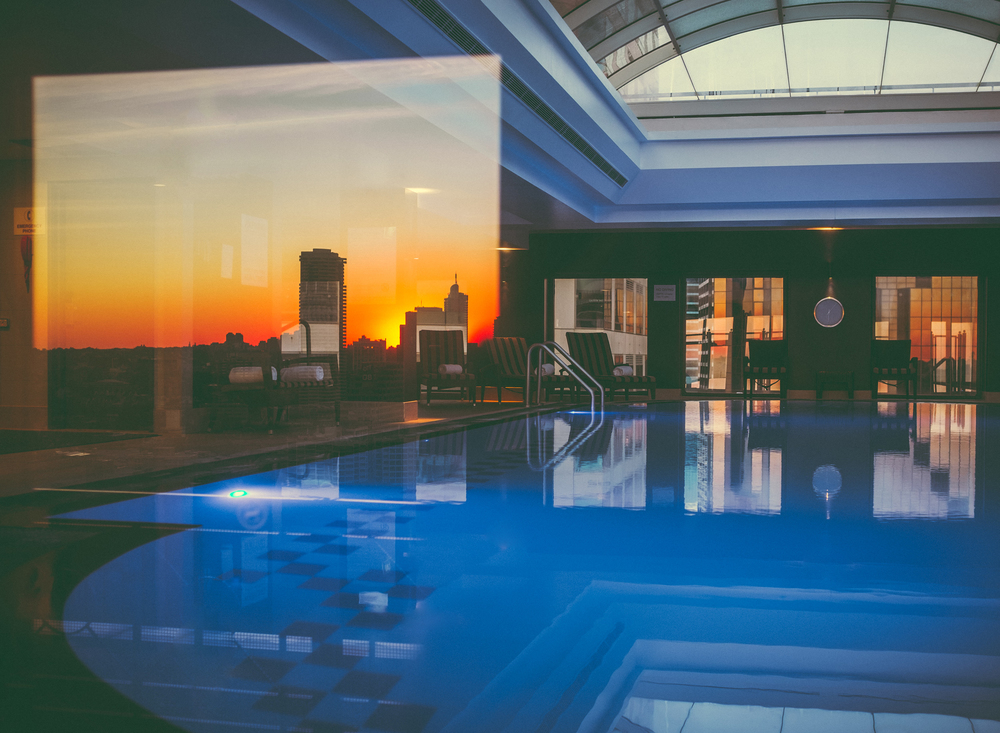 Window reflections in the pool area. Sunrise behind me before my 6am swim. This is the first photo taken on my new X100T.