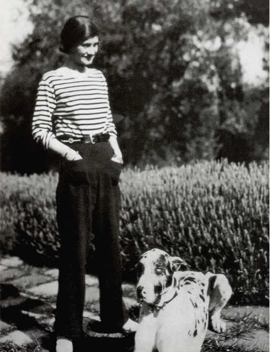 Coco Chanel and her dog Gigot in 1930