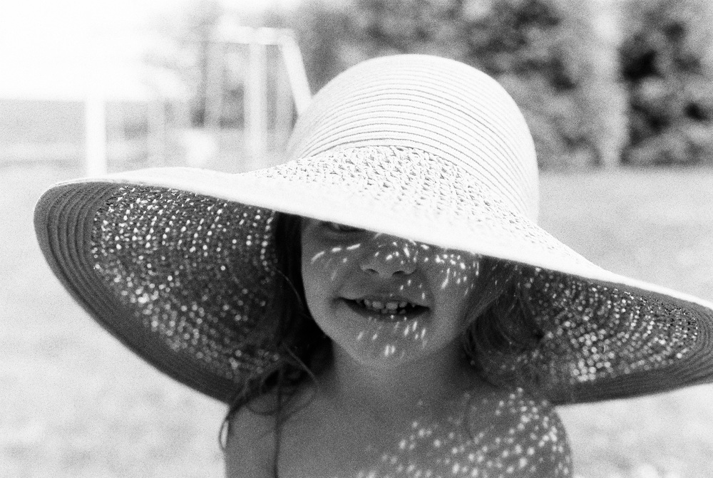 For these hat ones I put the meter under the hat in front of their face.  In the even lit one, she was standing in open shade f4.0 1/250.  In the dappled sunlight ones I had them stand in the sun. f4.0 1/400