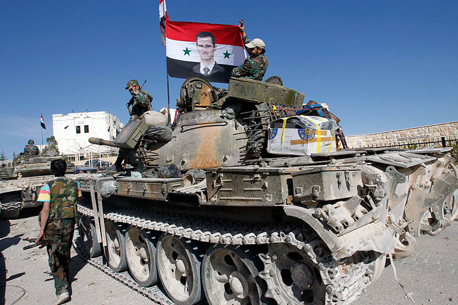 Борьба Башара Асада не закончена. Как предсказывают наблюдатели, дело идет к тому, что сирийский лидер договорится с жителями курдонаселенных регионов страны, чтобы выступить в борьбе с ИГИЛ и турецкими подразделениями одним фронтом. Фотоrussia-now.com