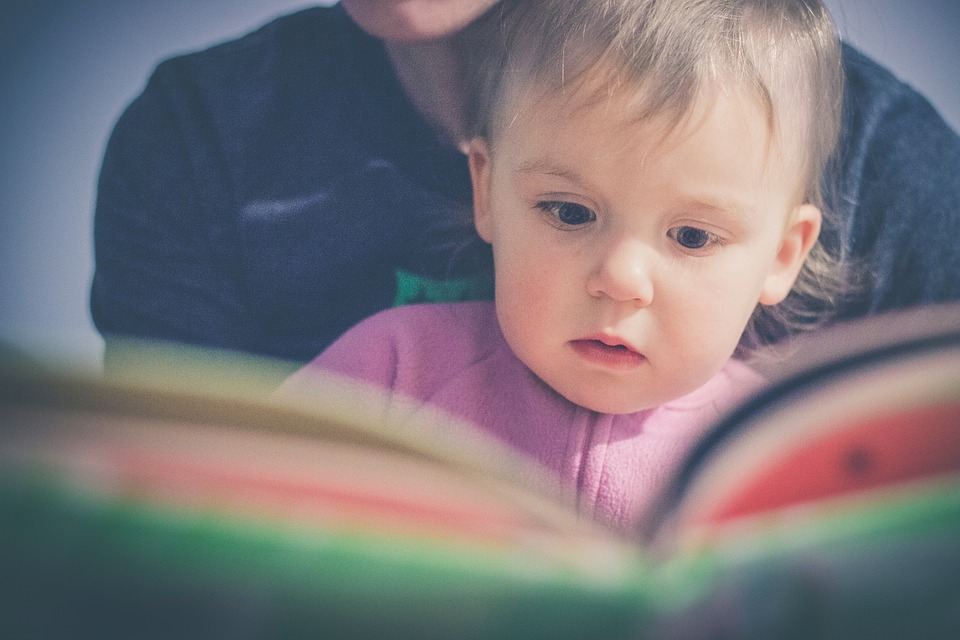 closeup of mom reading to toddler