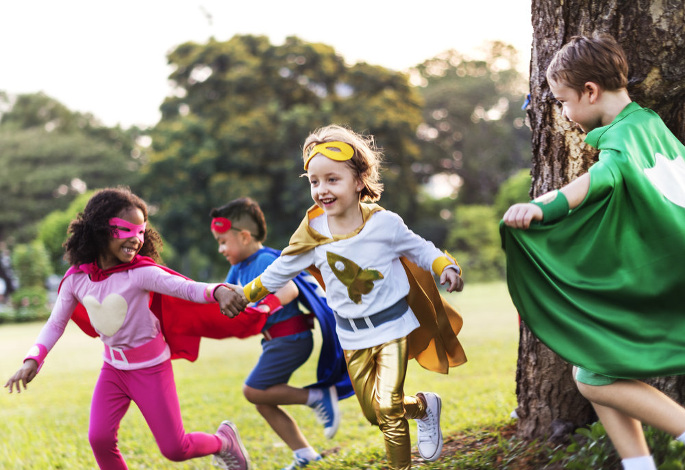 children playing in costumes