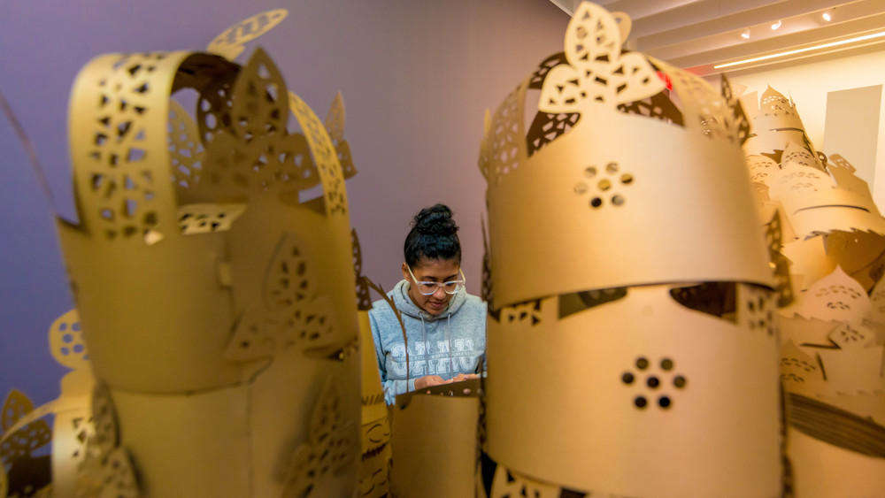 Shani Peters assembles the crowns in preparation for the opening of  The Crown Futures