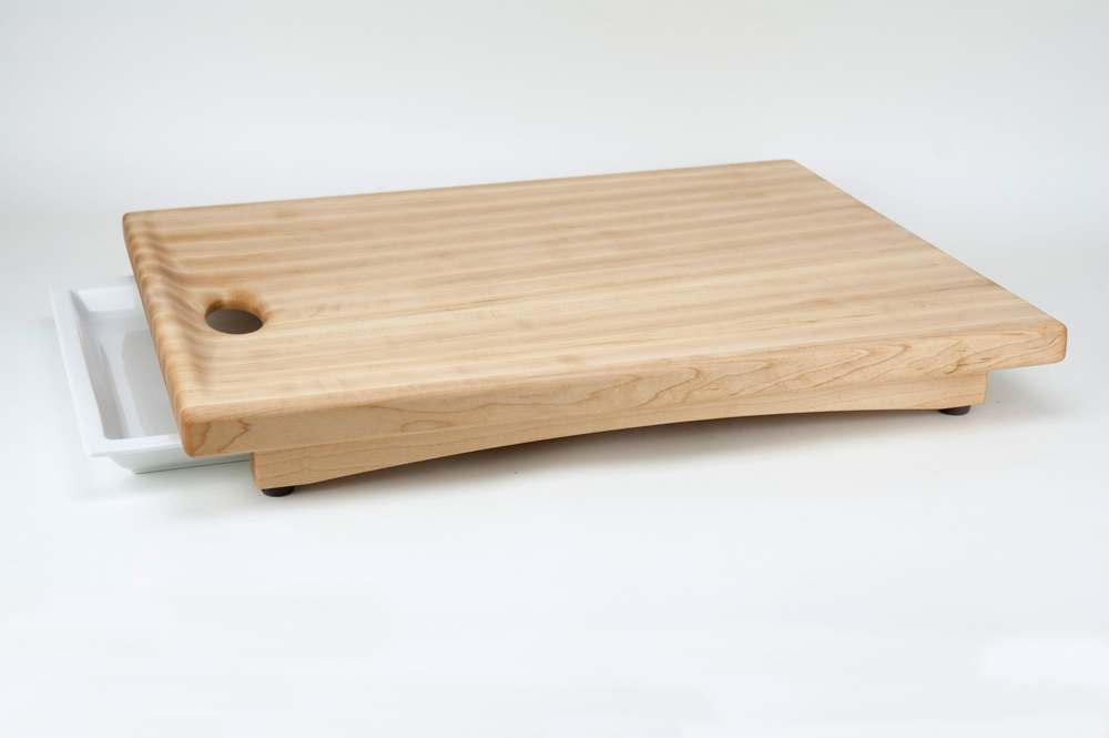 The nEAT Board: An evolutionary cutting/carving board in a league of its own.