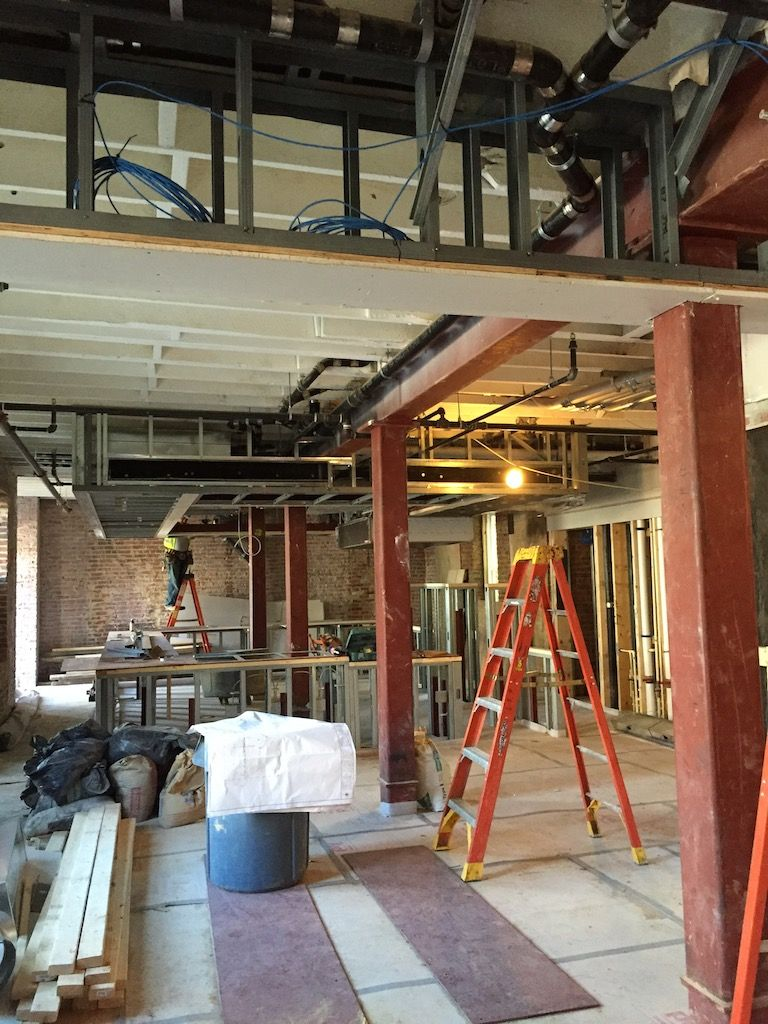 A view of the restaurant portion of the lobby. All the exposed brick will remain.