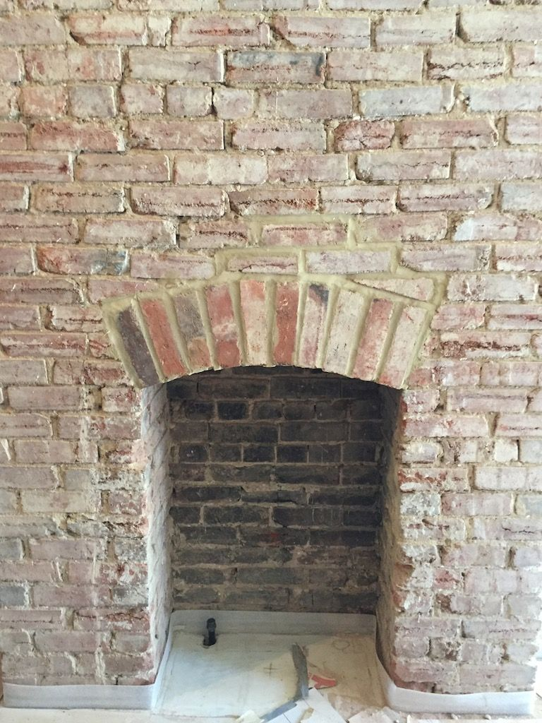 Workers unearthed this original fireplace, previously hidden behind a wall. It will remain exposed in the hotel bar area.