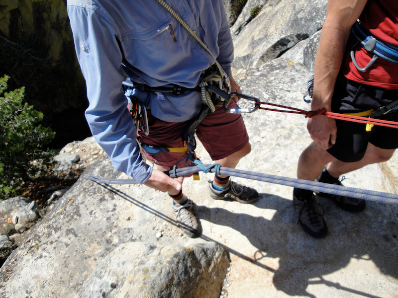 Rescuing an injured partner with a tandem rappel