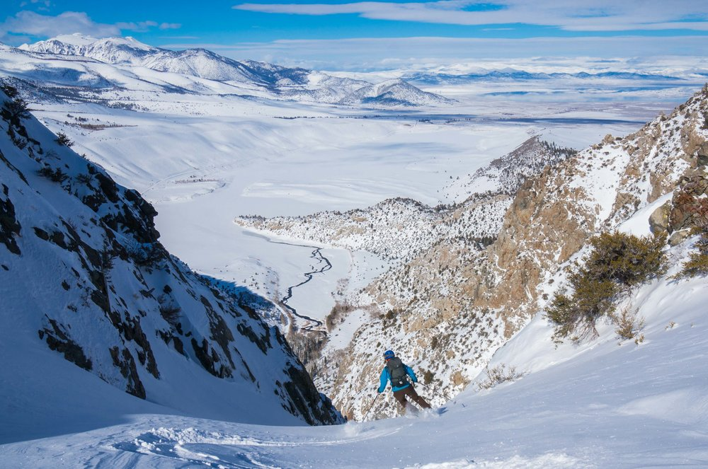 Dropping into a lower elevation couloir in june lake with mono lake in the background