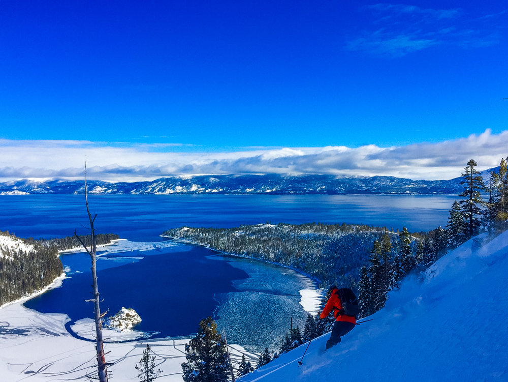 Skiing above a PARTIALLY frozen emerald bay