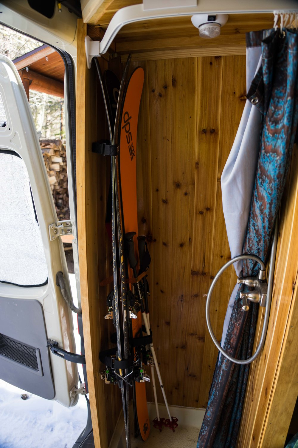 The shower and ski locker. velcro straps hold down the skis.